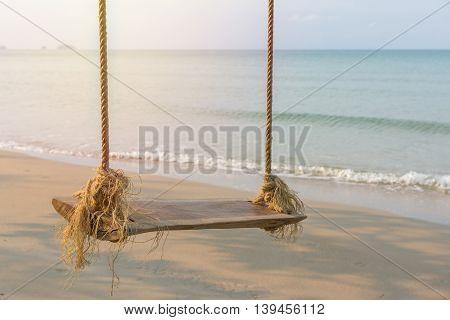 Rope Swing Under Tree On Ocean Beach