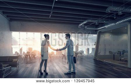 Business partnership handshake  .  Mixed media