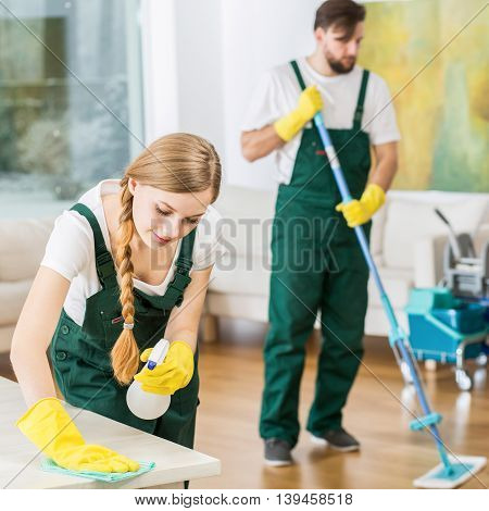 Young Cleaners Work At Modern House
