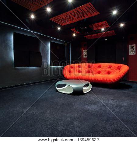 Red Sofa In Dark Room