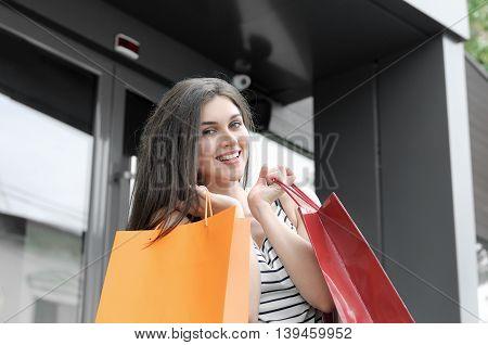 Beautiful Girl Showing Shopping Bags.