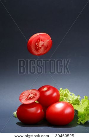 Cooking concept. Few freshness red tomatoes on dark background