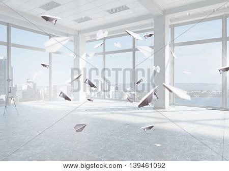 Paper planes in office .  Mixed media