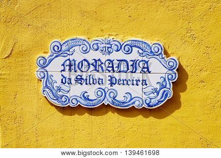 Traditional plate with the name of street on yellow wall, old Panaji,capital of Goa state,India (former Portuguese province)