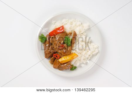 dish of meat and vegetable stir fry with rice