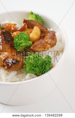 Stir-fried beef with cashews and broccoli served with rice
