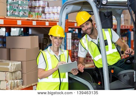 Portrait of workers are smiling and posing during work in a warehouse