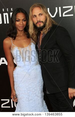 LOS ANGELES - JUL 20:  Zoe Saldana, Marco Perego at the