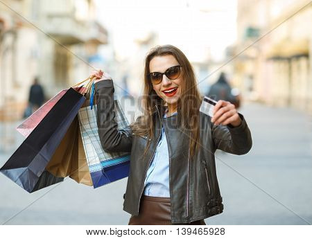 Sale shopping tourism and happy people concept - beautiful woman with shopping bags in the ctiy - Let's go shopping concept