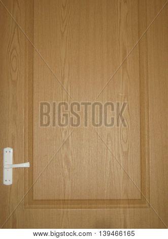 Wooden light brown room door background with white handle