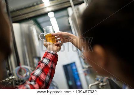 Brewers testing beer at brewery