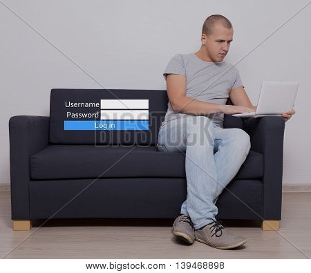 internet and social media concept - handsome man sitting using computer and login box