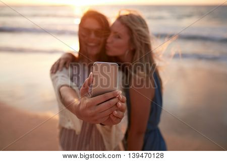 Woman Friends Taking Selfie At The Beach