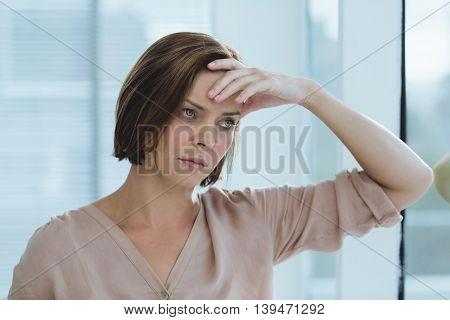 Sad woman looking away at home