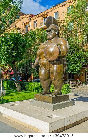 YEREVAN ARMENIA - MAY 29 2016: The monumental sculpture of Roman Warrior by F Botero in sculpture garden in Tamanyan street on May 29 in Yerevan.
