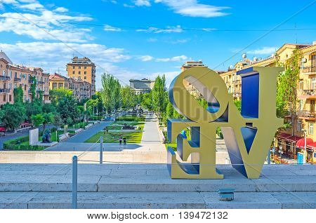 YEREVAN ARMENIA - MAY 29 2016: The view on the Cafesjian monument garden through the sculpture inscription Love by American artist Robert Indiana located on Cascade on May 29 in Yerevan.