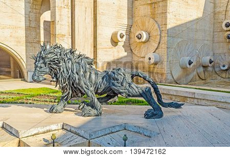 YEREVAN ARMENIA - MAY 29 2016: The sculpture of roaring and crouching lion made of tires on the third level of Cascade on May 29 in Yerevan.