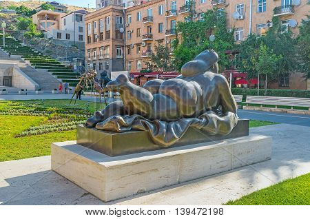 YEREVAN ARMENIA - MAY 29 2016: The sculpture of Fernando Botero named Smoking Woman the view from the back on May 29 in Yerevan.