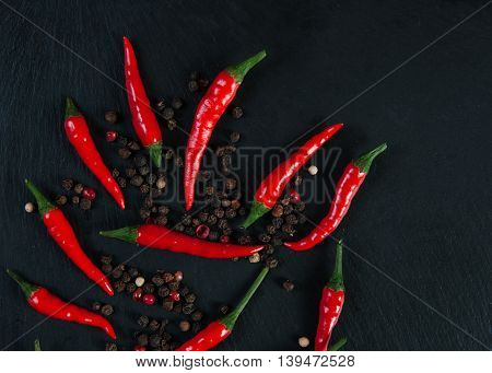 Red hot chili peppers on slate background