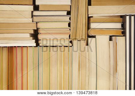 Antique books stacked on a storage rack. Read background. Culture