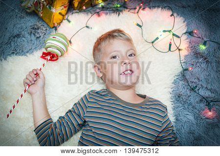 Cute boy meets a new year, christmas