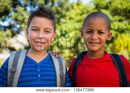 Portrait of smiling classmates at campus