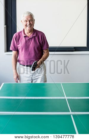 Senior playing ping-pong in a retirement home