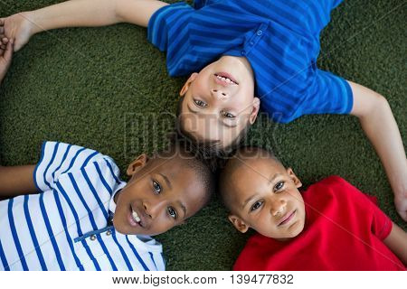 High angle portrait of children forming huddle at park