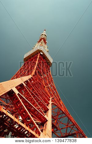 Tokyo - May 2016: Tokyo tower bottom view against blue sky. Retro look.