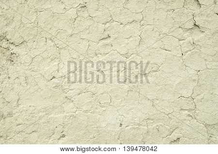 Old wall plastered with mud closeup in sunny day