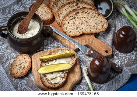 Slice Of Country Bread With Homemade Lard And Cucumber.