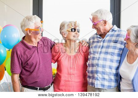 Seniors wearing funny glasses in a retirement home