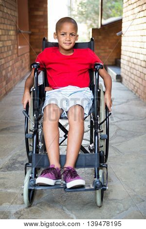 Portrait of handicapped boy at school corridor