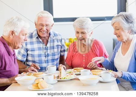 Seniors having lunch together in a retirement home