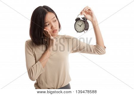 Young Asian Business Woman Is  Stressed With A Clock