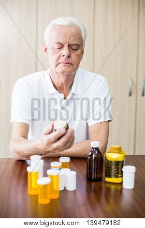 Senior looking at medicine in a retirement home