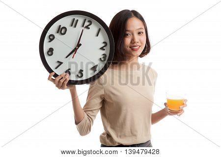Asian Woman With A Clock Drink Orange Juice