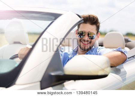 Man in convertible