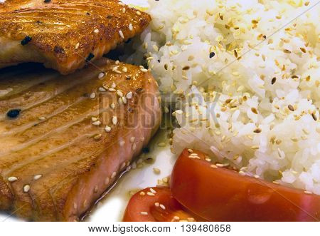 fried fish with rice and tomatoes on white background