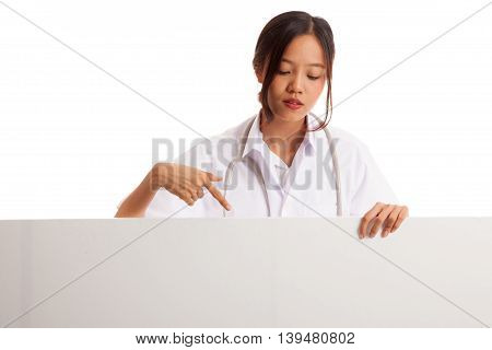 Young Asian Female Doctor Point And Look Down To Blank Sign