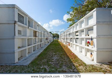 KEY WEST FLORIDA USA - MAY 02 2016: Above ground vaults at the Key West cemetery. It is a 19-acres cemetery and about 100.000 people are buried here.