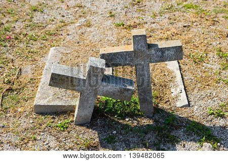 KEY WEST FLORIDA USA - MAY 02 2016: Two crosses on graves at the Key West cemetery. It is a 19-acres cemetery and about 100.000 people are buried here.