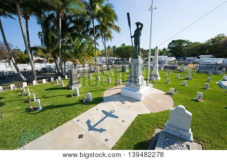 KEY WEST FLORIDA USA - MAY 02 2016: Statue in the middle of the battleship Maine memorial section at Key West cemetery.