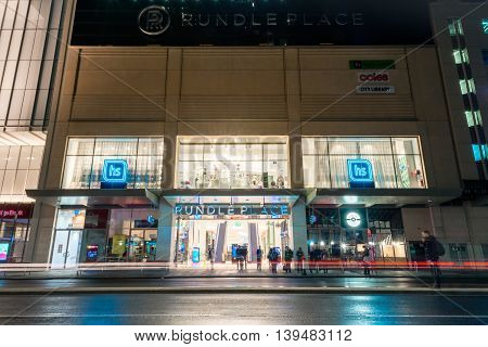 Adelaide South Australia - August 11 2015: View at Rundle Place with people on the bust stop. Rundle Place is very famous shopping complex in Adelaide