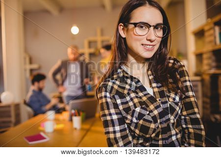 Portrait of graphic designer in spectacles at office