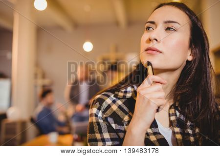 Close-up of thoughtful graphic designer in office