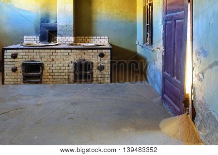 Oven in the abandoned ghost diamond town of Kolmanskop in Namibia which is slowly being swallowed by the desert Africa