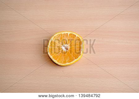 Tangelo Citrus Slice On A Wooden Background