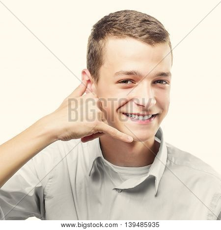 Portrait of happy man calls for an improvised phone - isolated on white. Concept communication. Toned photo.