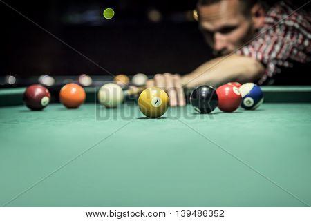 Billiard balls in a green pool table.